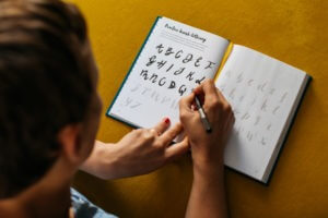 The Positive Bullet Diary open showing details of calligraphy practice included in