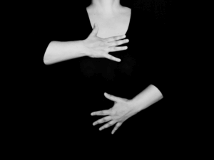 A picture showing a person placing one hand on their chest and the other on their abdomen to find out where they breathe from. A key point in breathing techniques for anxiety