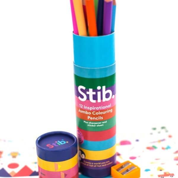 The Stib Positive Jumbo Colouring Pencils in their storage tube with a bright orange pencil sharpener and Stibler stickers