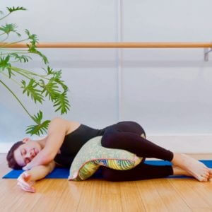 Yoga teacher James Downs demonstrates the restorative yoga pose the Foetal position