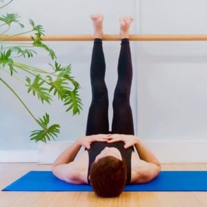 Yoga teacher James Downs demonstrates the yoga pose legs up the wall for relaxation
