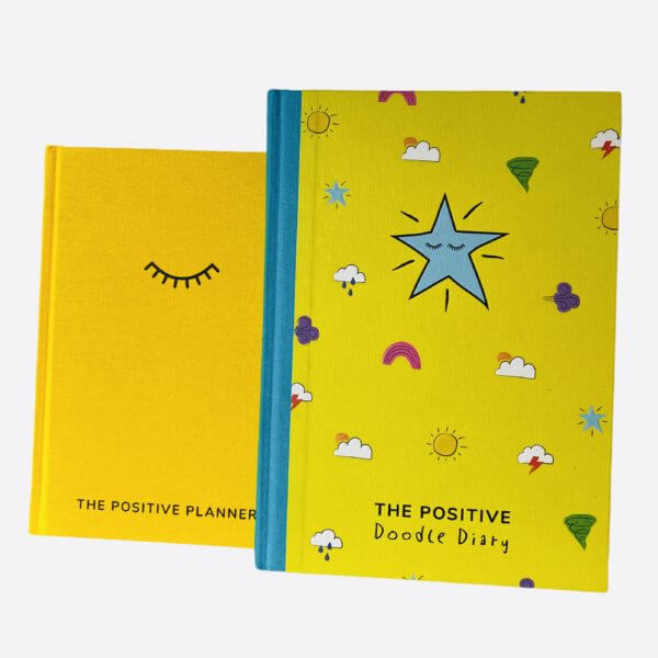 The Parent Pack comprises the yellow Positive Planner and larger Positive Doodle Diary