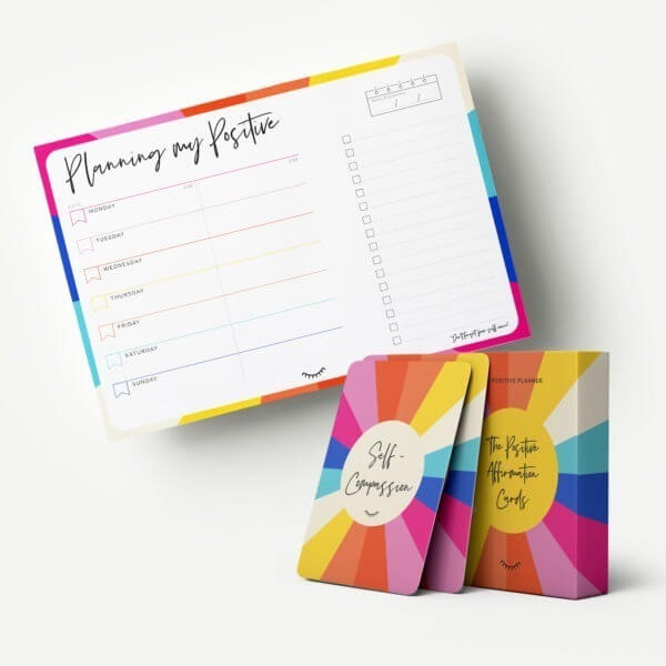 The Desktop Pack showing the bright and colourful Positive Affirmation Cards and The Positive Week Desk Pad Planner