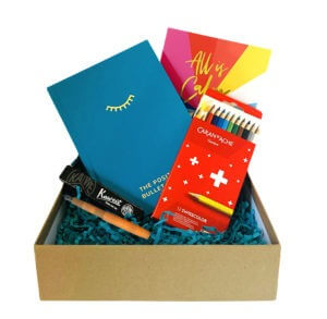 The Stationery Lover's Box with The Positive Bullet Diary, a Kaweco Fountain Pen, Caran D'Ache Colouring Pencils and The Positive Planner Christmas Card