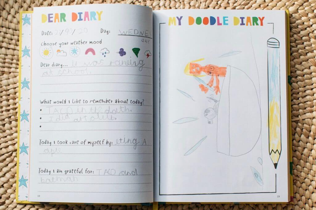 An open page of The Positive Doodle Diary showing the Dear Diary page filled in by a child - this is an ideal way to help children learn about their emotions