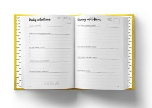 An open Positive Planner showing the Daily Pages - an easy starting point as a tip for people who can't journal